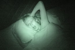 Woman screaming in bed at night